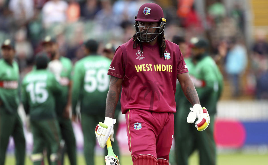 West Indies' Chris Gayle walks back to the pavilion after being dismissed for a duck. Mohammad Saifuddin dismissed the swashbuckling opener after he went 13 balls remaining scoreless. AP