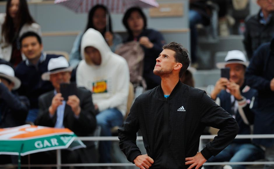 The players split the first two sets — Thiem took the opener 6-2, then Djokovic grabbed the second 6-3 — and Thiem was up a break at 3-1 in the third when action was halted. AP