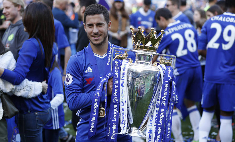 """Britain Football Soccer - Chelsea v Sunderland - Premier League - Stamford Bridge - 21/5/17 Chelsea's Eden Hazard celebrates with the trophy after winning the Premier League Action Images via Reuters / John Sibley Livepic EDITORIAL USE ONLY. No use with unauthorized audio, video, data, fixture lists, club/league logos or """"live"""" services. Online in-match use limited to 45 images, no video emulation. No use in betting, games or single club/league/player publications. Please contact your account representative for further details. - 14796808"""