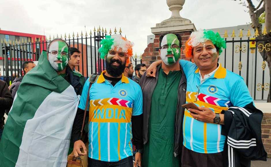 Rivals on the field, friends off it! India and Pakistan fans are all smiles ahead of the encounter in Manchester. Firstpost/Jigar Mehta