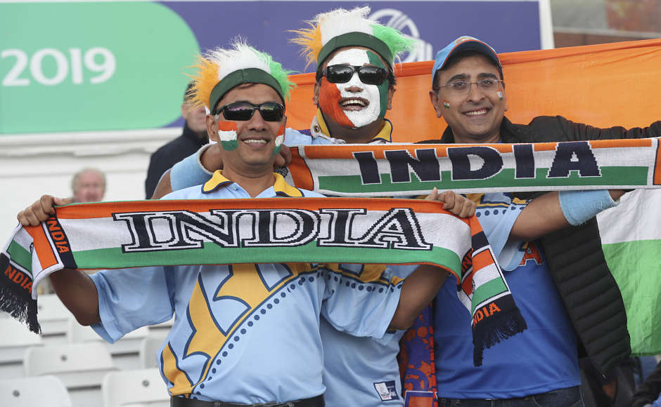 Here's some cheerful Indian fans in the picture. Virat Kohli-led India are yet to lose a match in this tournament despite Thursday's washout. AP