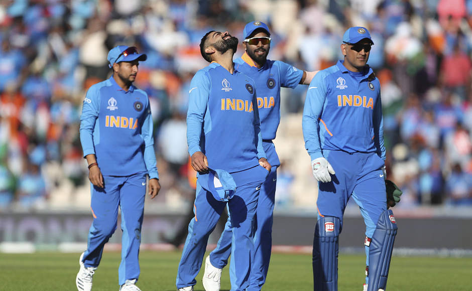 Virat Kohli leads some of his teammates back to the pavilion following India's win. The Men in Blue moved a step closer to the semi-finals with this win. AP