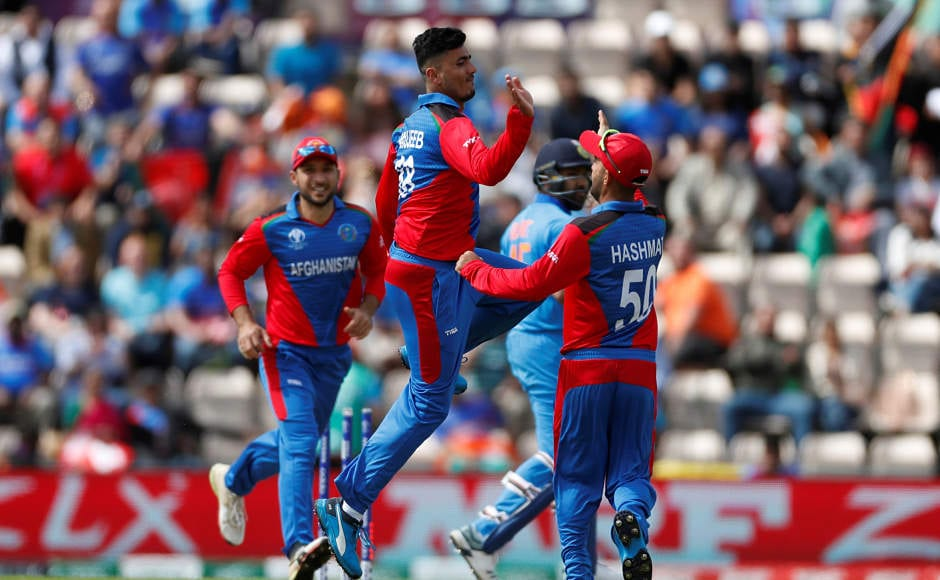 Mujeeb Ur Rahman celebrates after seeing off Rohit Sharma. The opener was dismissed as early as in the fourth over as the Men in Blue got off to a shaky start. Reuters