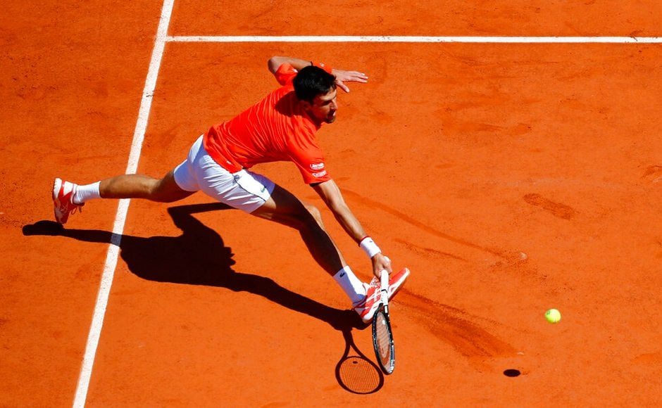 Novak Djokovic's 26-match Grand Slam winning streak ended in the French Open semi-finals because he made some odd strategic choices, because the wild weather bothered him, because the chair umpire got under his skin. AP