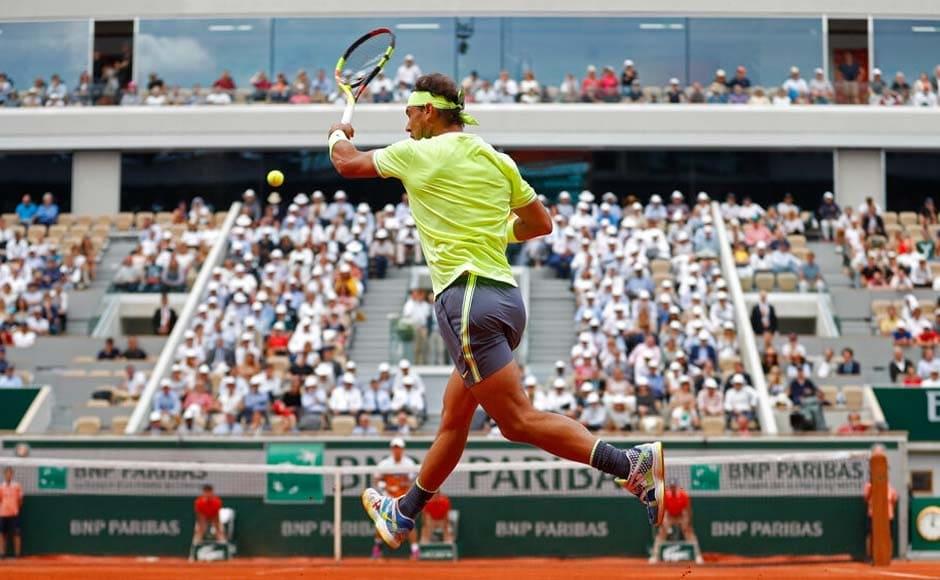 Rafael Nadal advanced to a record-extending 12th Roland Garros semi-final with a dominant 6-1, 6-1, 6-3 win over Kei Nishikori. AP