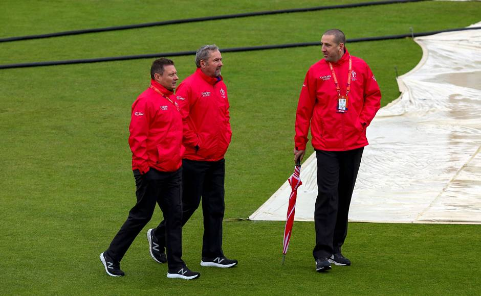 Umpires Richard Kettleborough, Richard Illingworth and Michael Gough inspect the pitch after rain delayed the start of the 2019 Cricket World Cup group stage match between Bangladesh and Sri Lanka. No toss could take place in the match. AFP