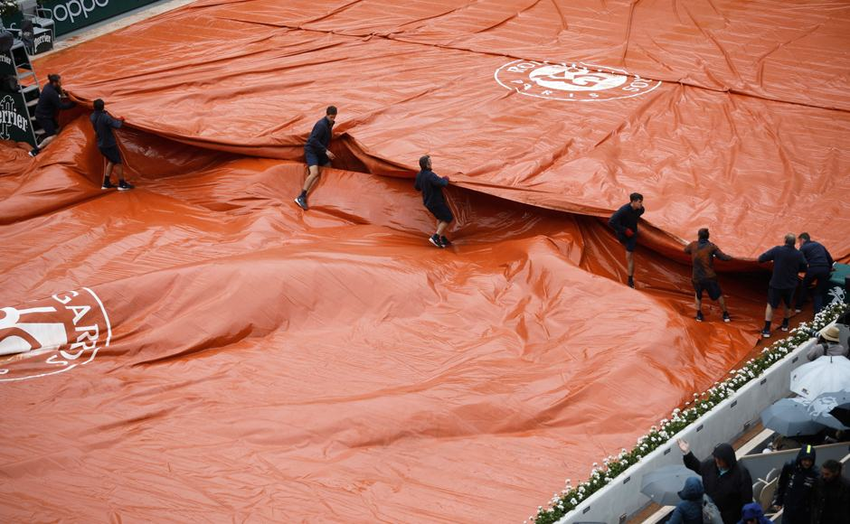 About 45 minutes later, tournament officials announced the match would resume Saturday. AP