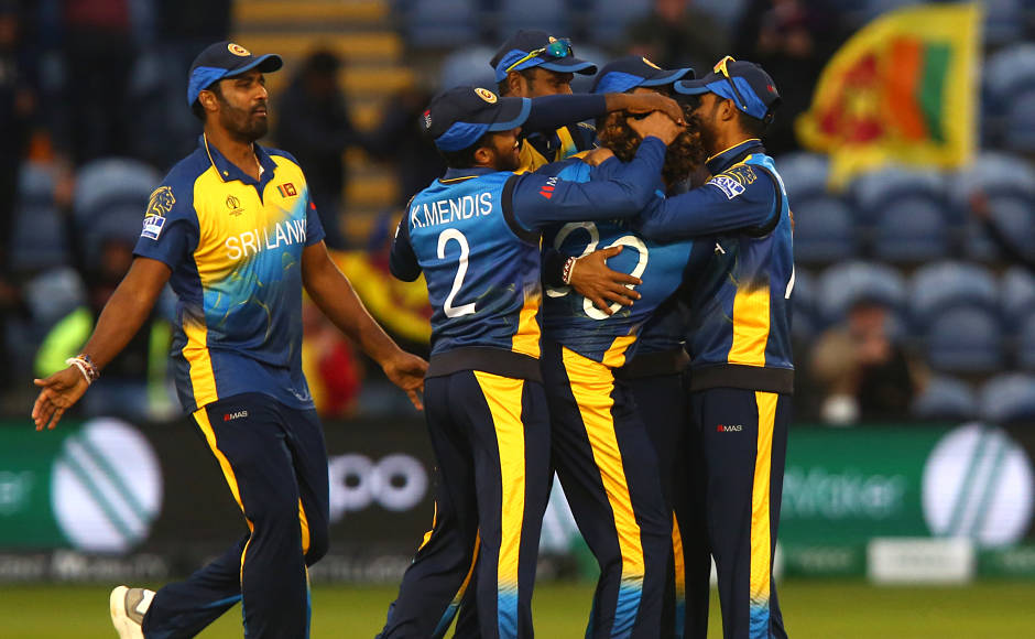 Sri Lanka players celebrate their 34-run win over Afghanistan, thereby getting their first couple of points on board. AFP