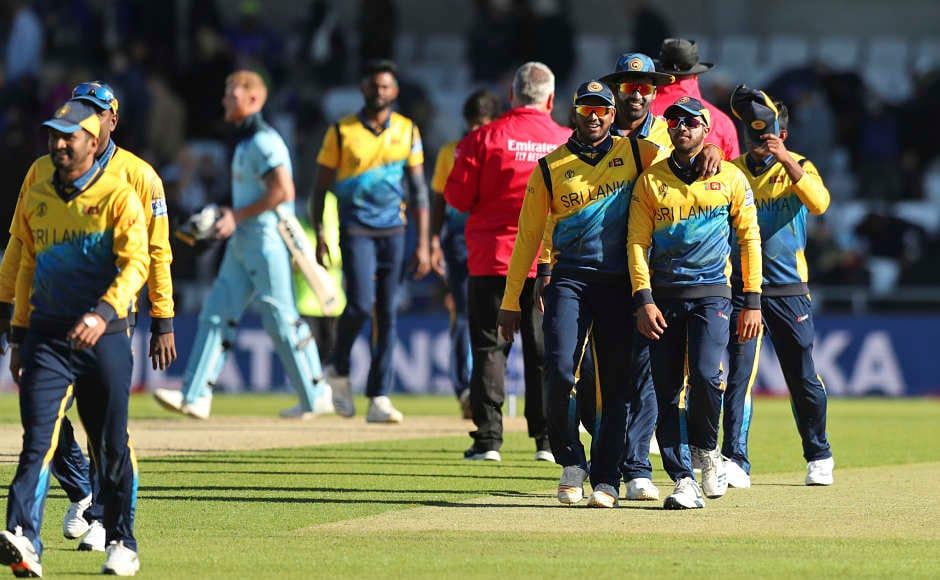 Sri Lanka cricketers celebrate after beating England by 20 runs in their World Cup encounter. This was England's second loss, whereas the Islanders boosted their semi-final hopes yet again. AP