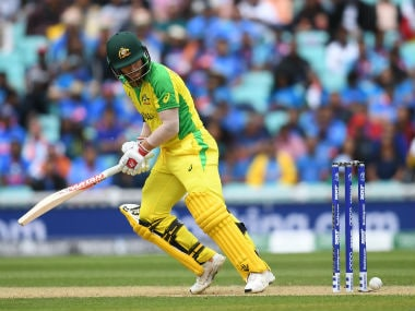 Australia's David Warner looks back as the ball touches his stumps but does not dislodge the bails during the 2019 Cricket World Cup group stage match between India and Australia. AFP