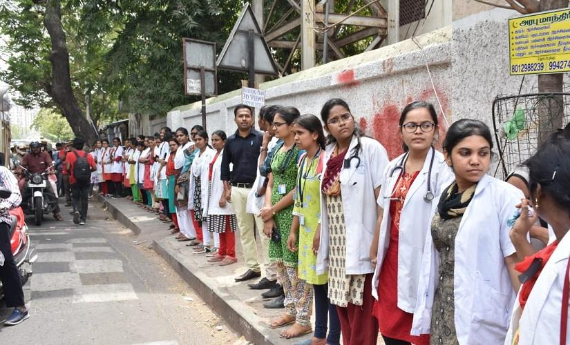Doctors at several hospitals registered their protest by wearing bandages on their foreheads, black arm-bands and some even put on helmets as a sign of protest. The IMA had launched a four-day nationwide protest from Friday over the Kolkata incident and wrote to Union Home Minister Amit Shah demanding enactment of a central law to check violence against healthcare workers. Image courtesy: Mydeen Abdul Kathar/101Reporters