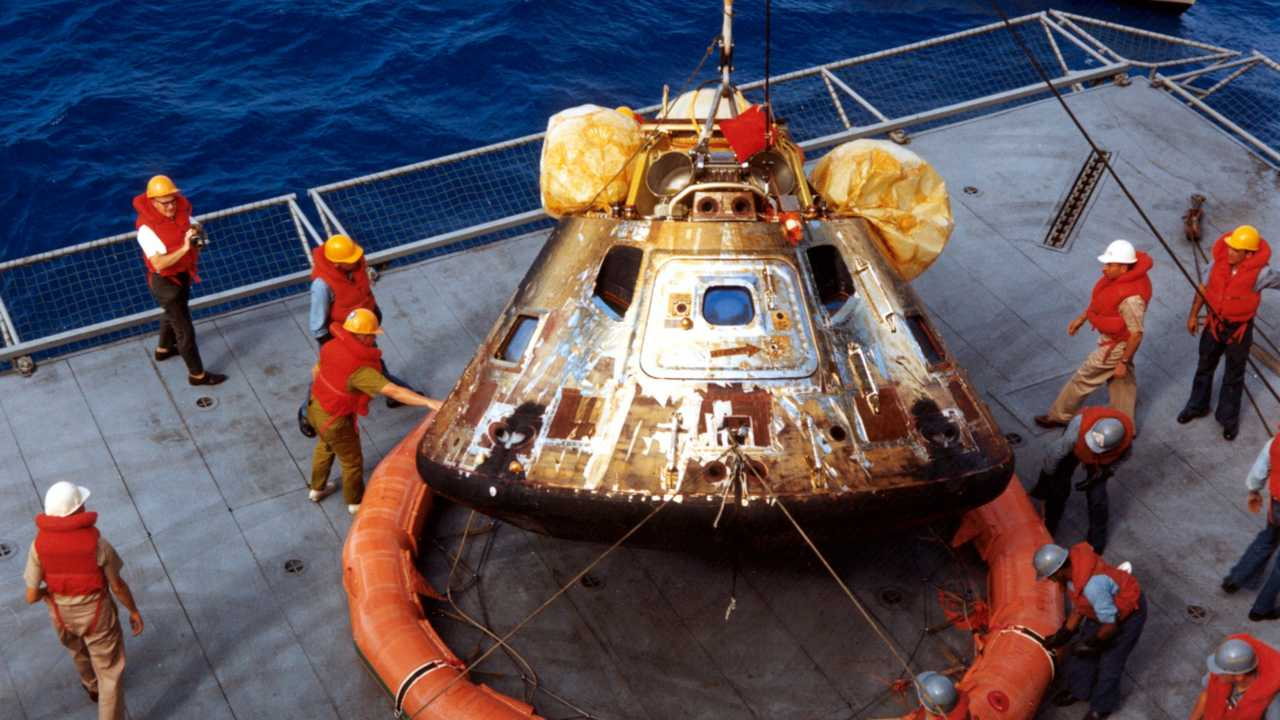 The Apollo 11 spacecraft Command Module being lowered to the deck of the U.S.S. Hornet. Source: ALSJ/NASA