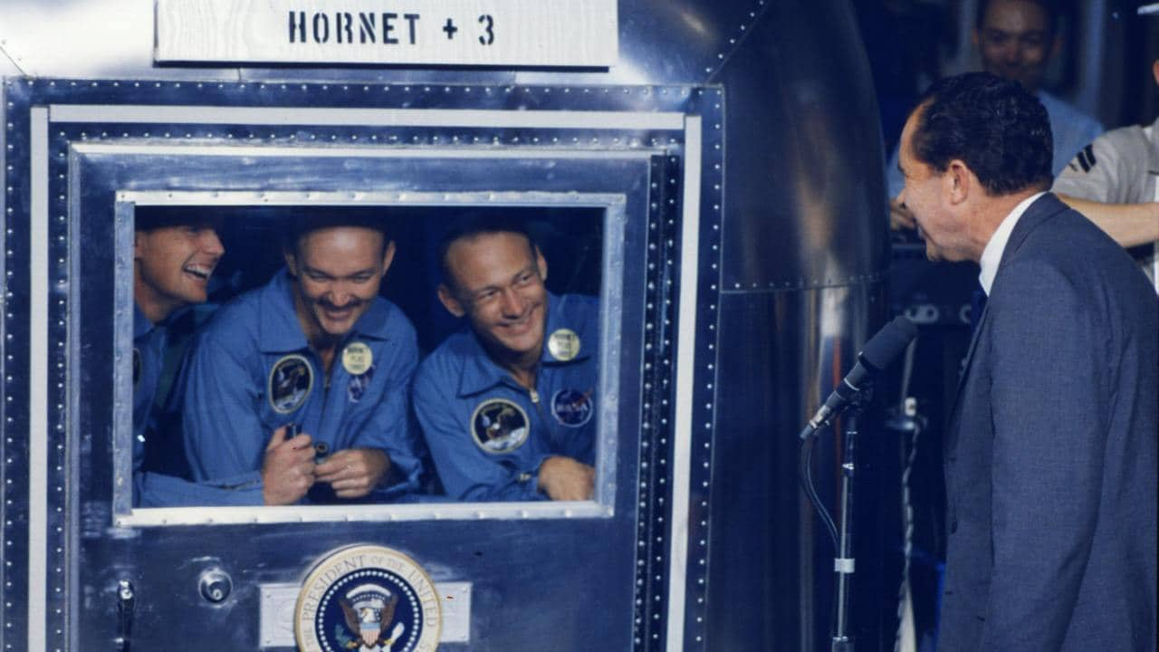 Then President Richard Nixon looks receives the returning trio - Buzz Aldrin, Neil Armstrong and Michael Collins. Source: ALSJ/NASA