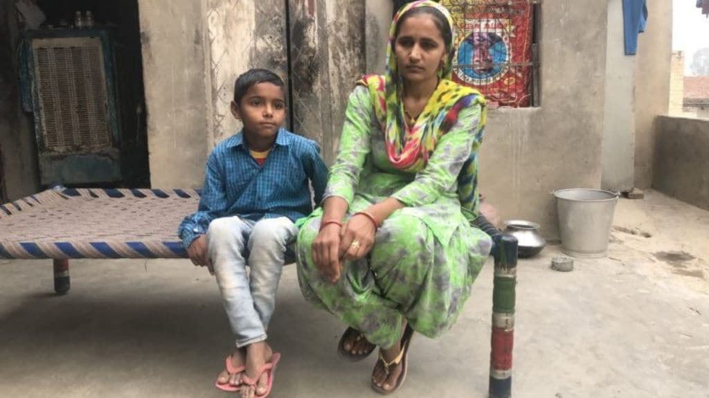 Manju Singh of village Andana in Sangrur with her son Kapil. Her husband Manvir Singh committed suicide after he couldn't pay his tubewell loan. Photo by Sunaina Kumar.