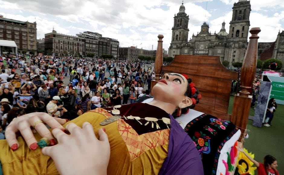 Crowds swarmed around the large creation of the artist lying on a bed. Many of Kahlo's paintings were self-portraits, her style was characterised by the vivid use of colour even as she explored several themes around death. Reuters/ Luis Cortes