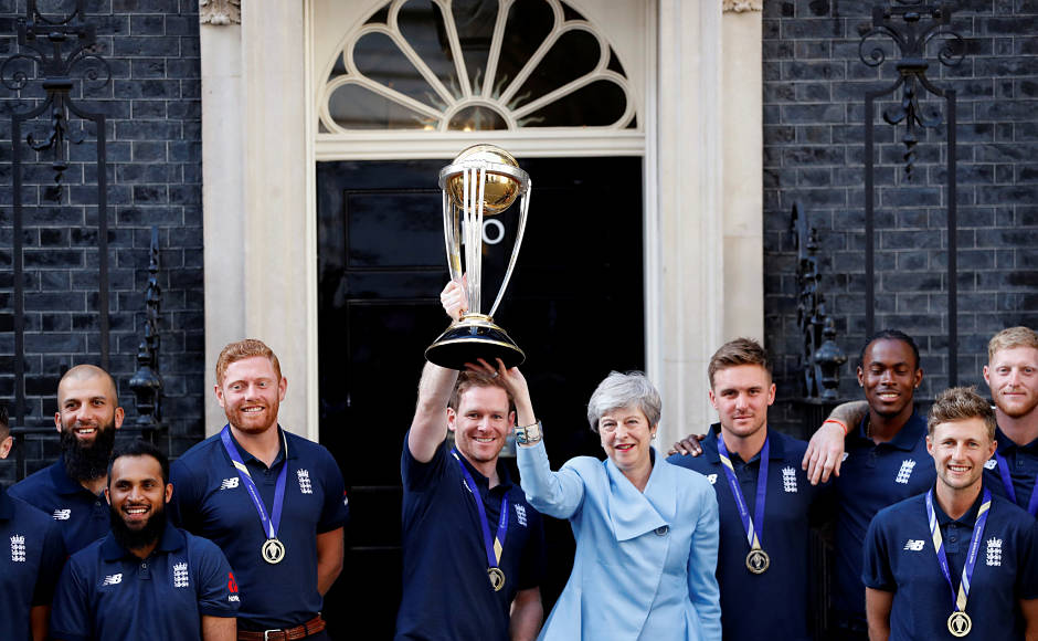 Players of England's Cricket World Cup-winning team post for a picture with Great Britain's Prime Minister Theresa May at 10 Downing Street, London. Here, England captain Eoin Morgan and Theresa May are holding aloft the trophy. Reuters