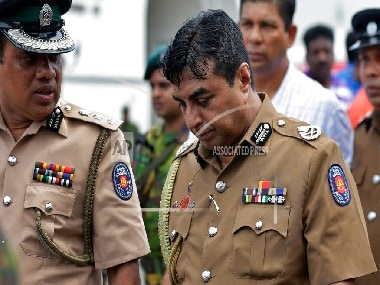 Sri Lankas former defence secretary, suspended police chief detained over Easter Sunday bombings which claimed more than 250 lives