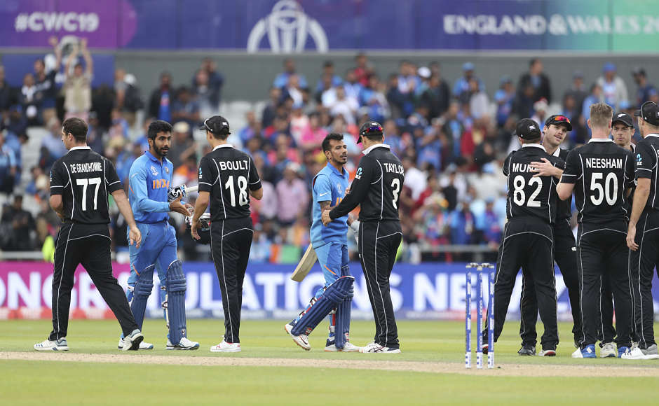 India and New Zealand players shake hands after the latter clinched a thrilling win to reach the Cricket World Cup final for the second consecutive time. AP
