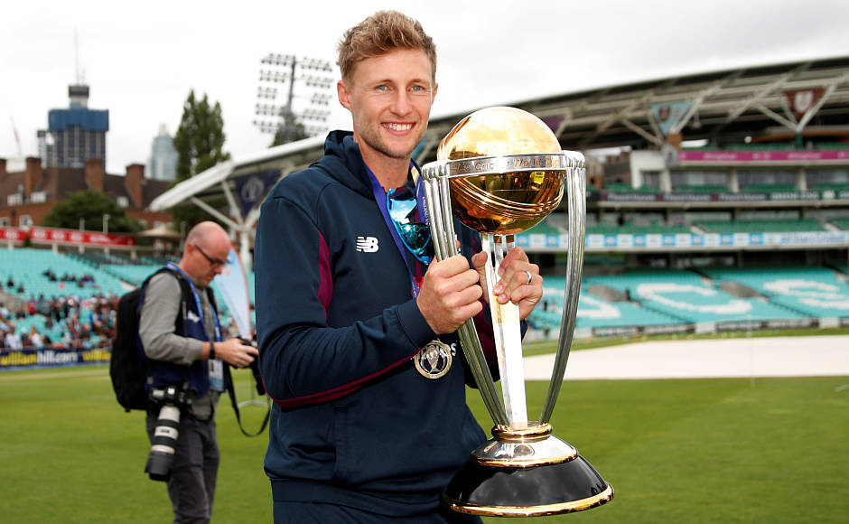 England's Joe Root poses for a picture with the World Cup trophy at The Oval in London on Monday. Reuters