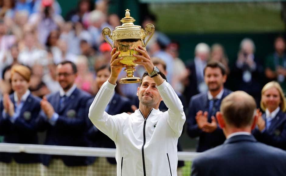 Novak Djokovic beats Roger Federer in historic five-set thriller to win fifth Wimbledon title
