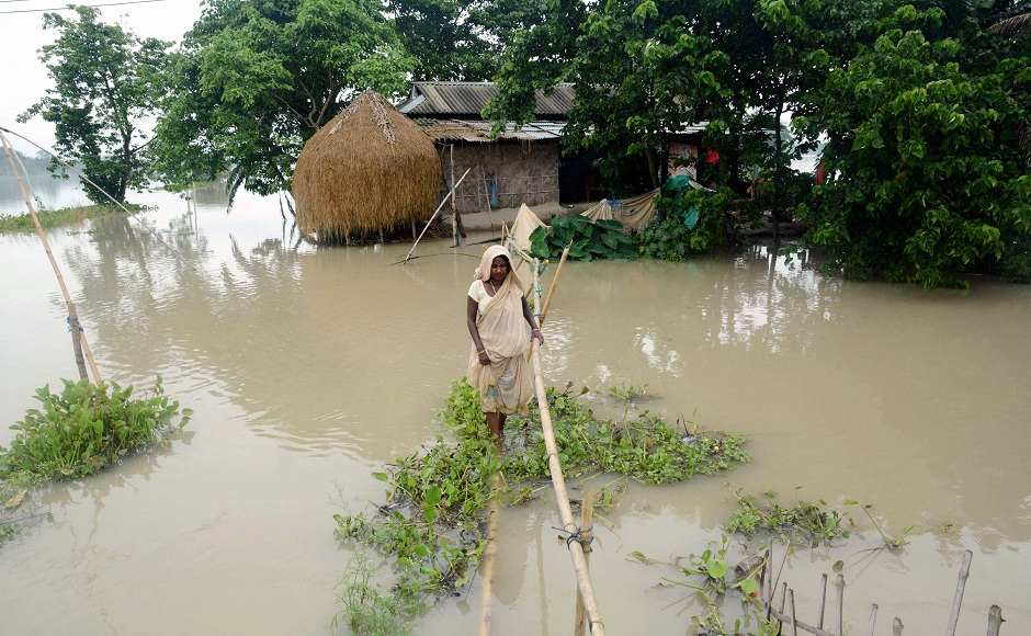 Torrential downpour in the state of Assam continued to wreak havoc on Monday, causing flooding on National Highway 37 and affecting 200 villages in Morigaon district alone due to the rising water levels of river Brahmaputra. PTI