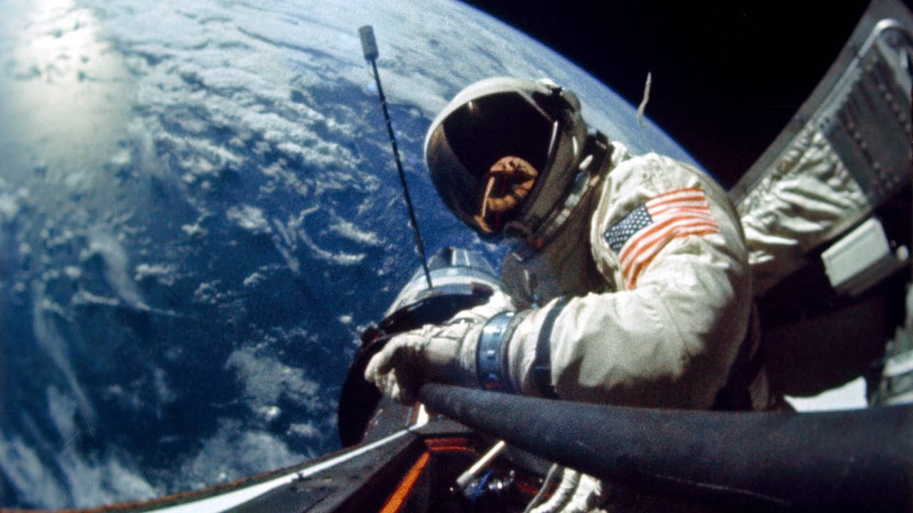 Buzz Aldrin performs an EVA during the Gemini XII mission. The Agena Target Vehicle is visible in the background. Image credit: NASA