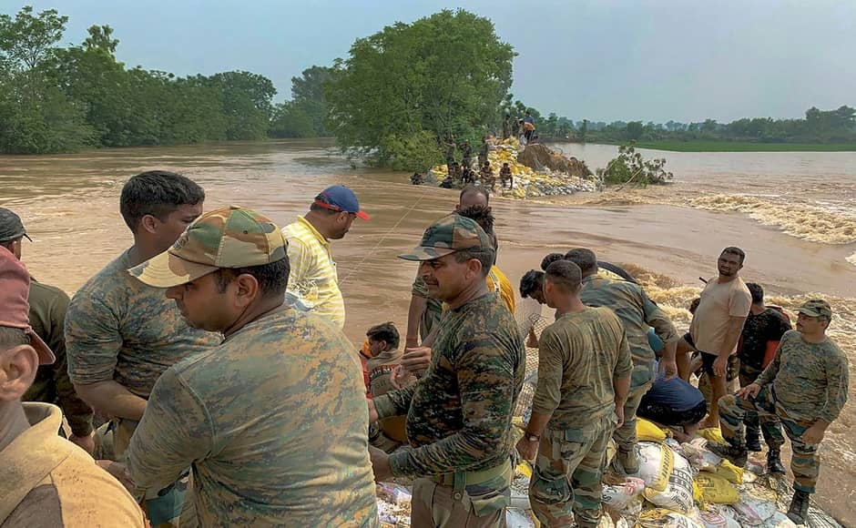 Heavy monsoon rains have caused overflowing of the Ghaghara River in Punjab's Sangrur. Army personnel seen constructing an embankment along the river to contain the flood situation at Moonak. PTI