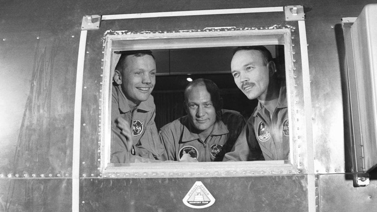 Apollo 11 crew members, from left, Neil Armstrong, Buzz Aldrin and Michael Collins sit inside a quarantine van in Houston. Image: AP.