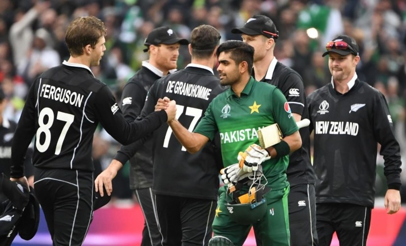 Babar Azam is congratulated by New Zealand players. AFP