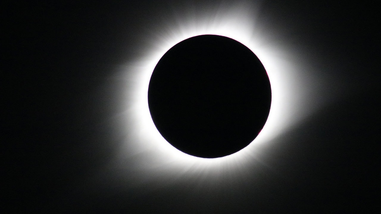 See the solar eclipse dip the Earth into darkness