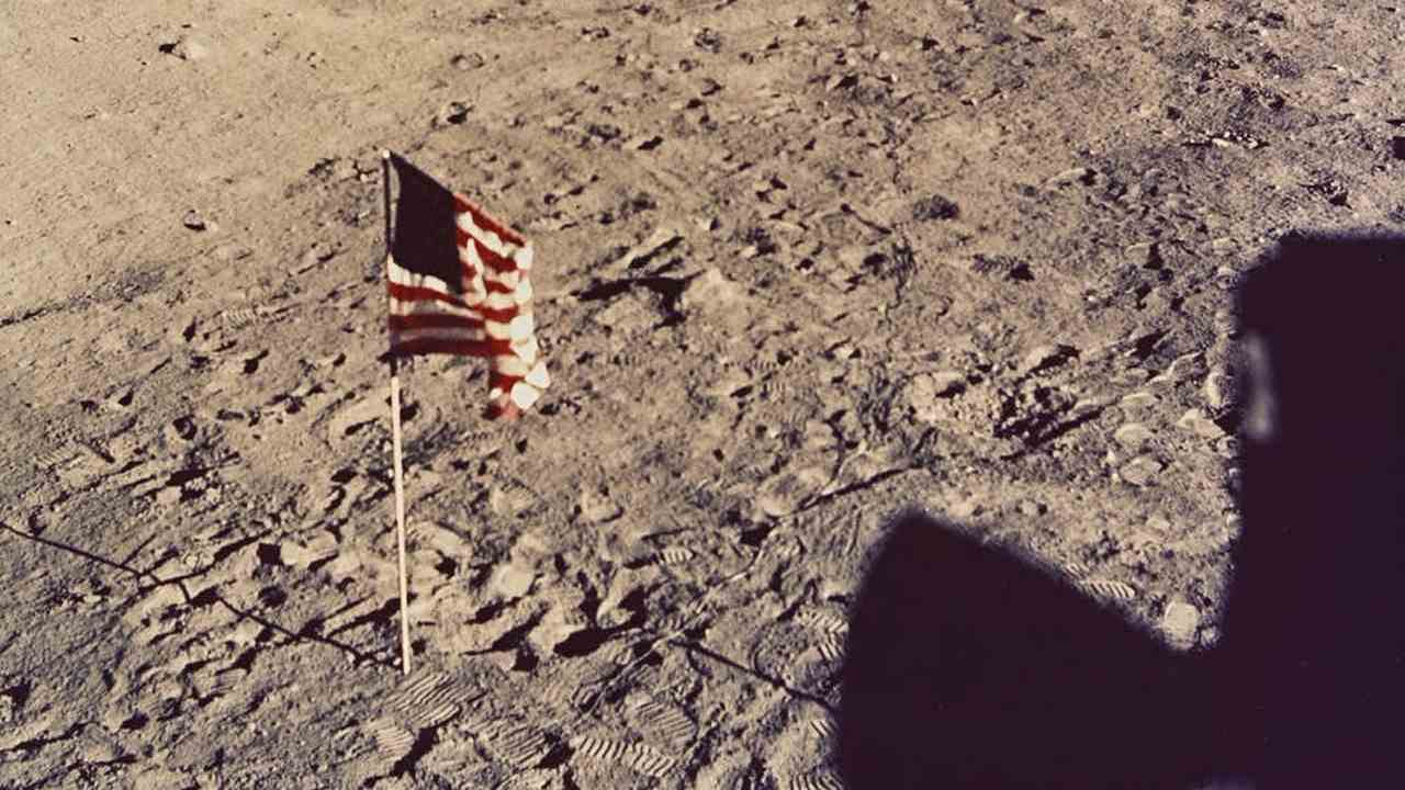 NASA Washington DC, United States flag on moon surface with lunar surface television camera in background 1969, type C photograph. National Gallery of Victoria, Melbourne. Purchased 1980