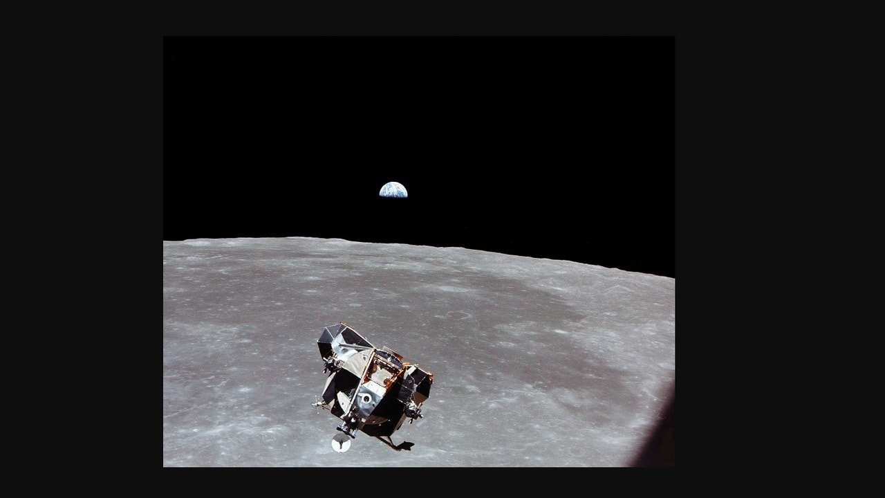 Lunar module approaches command and service module for docking and the Earth rise is in background. Image credit: NASA