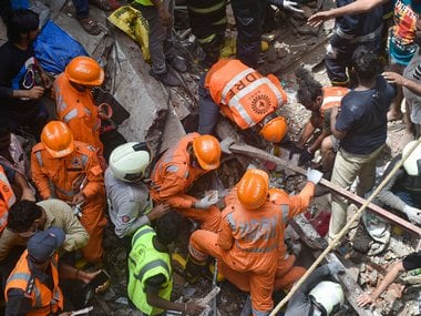 Fire Brigade and NDRF personnel carry out rescue works after the collapse of the four-storey Kesarbai building at Dongri in Mumbai. PTI