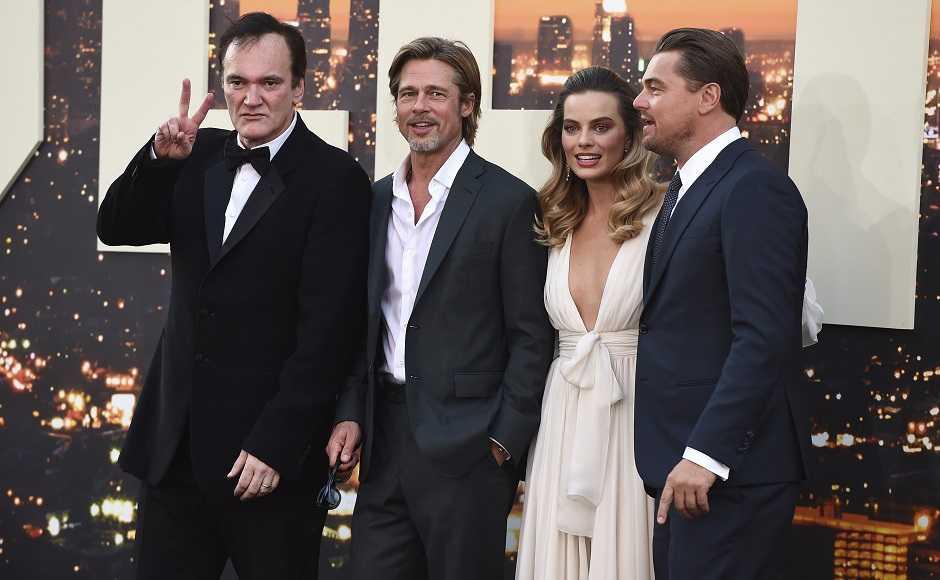 The film's cast pose alongside director Tarantino at the premiere. AP