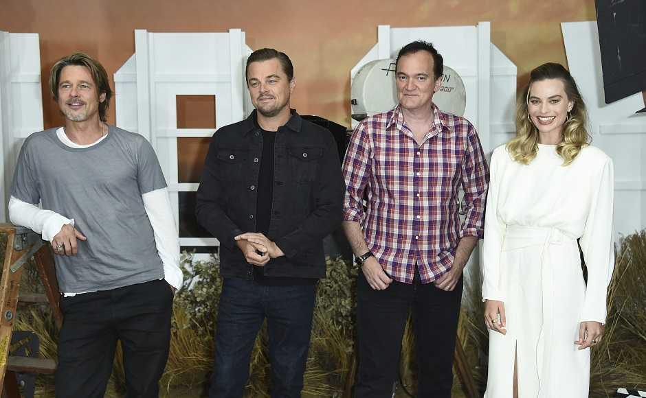 Brad Pitt, Leonardo Di Caprio, Quentin Tarantino and Margot Robbie. AP