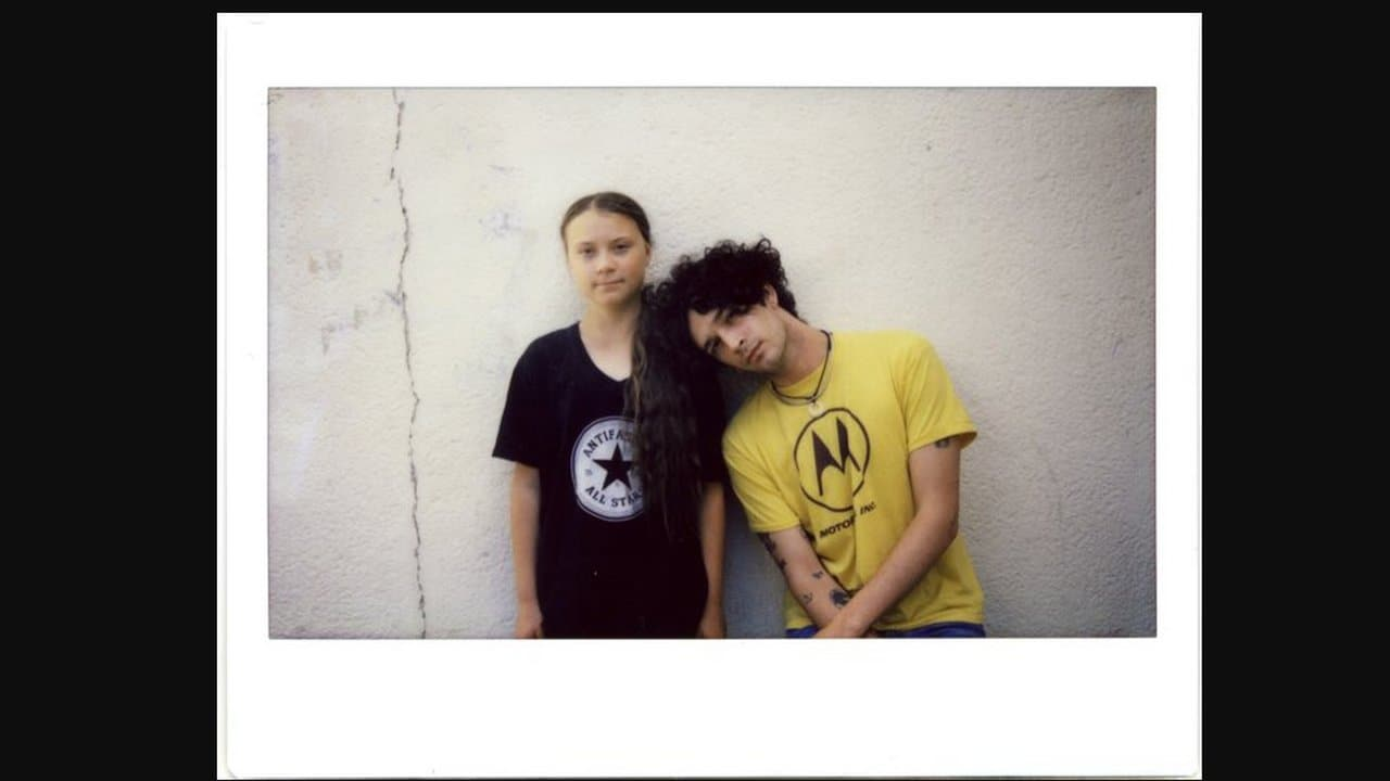 Lead singer Mathew Healey with Greta Thunberg. image credit: Twitter/The 1975