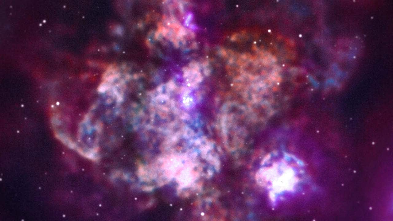 "The 30 Doradus, nicknamed ""Tarantula Nebula,"" is one of the largest star-forming regions located close to the Milky Way. This image has data from 24 days of observation. Image credit: NASA/CXC"