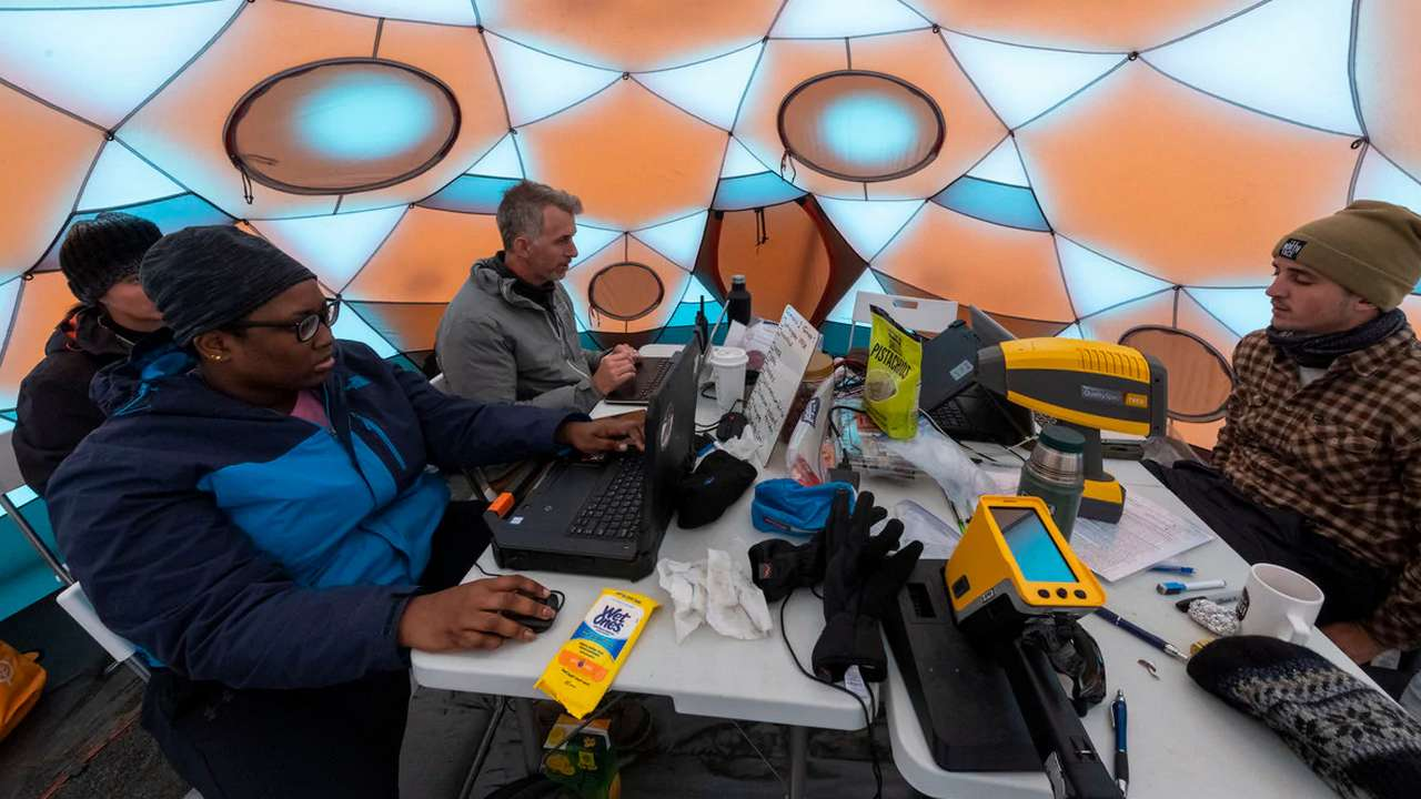 Scientists working at the NASA base at the Lambahraun lava field in Iceland Image Credit: Halldor Kolbeins/ AFP
