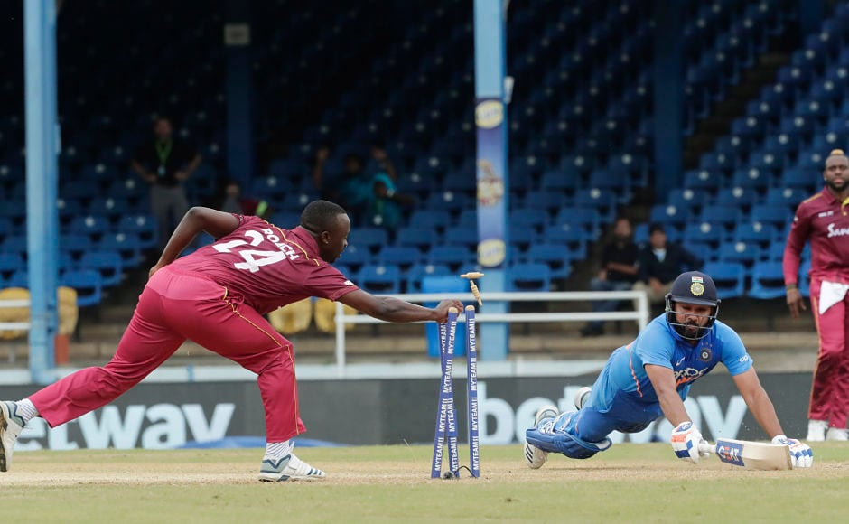 India's chase started on a shaky note, with Rohit Sharma getting run out after scoring just 10 runs. AP