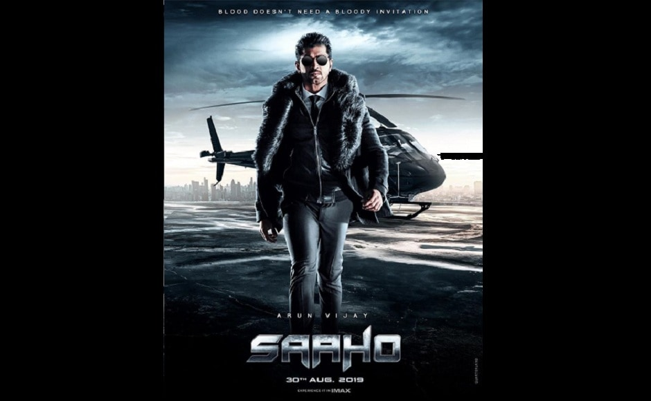 Arun Vijay who plays Vishwank in Saaho, is seen in a fur coat and sunglasses, walking away from a helicopter in his character poster.