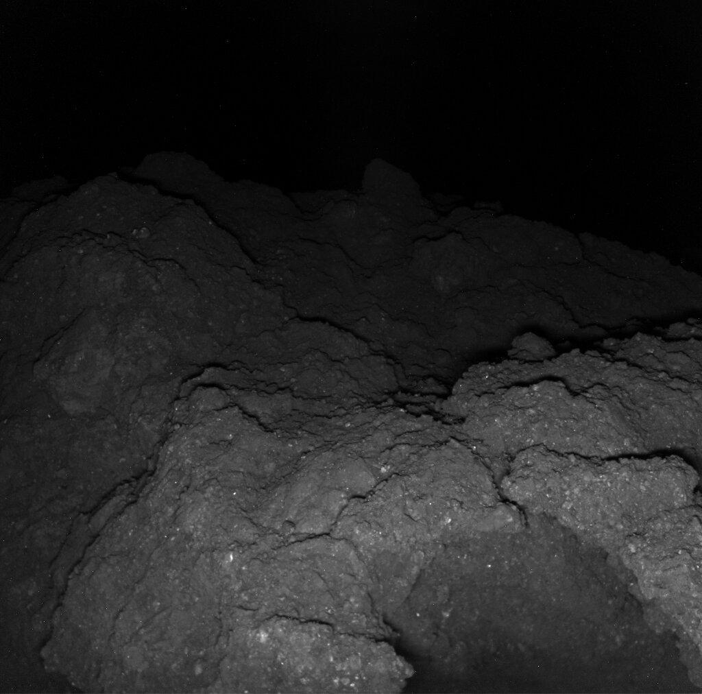 Before first contact with a large rock on Ryugu, MASCAM photographed the area of Hayabusa's descent with a backward-facing view. Image: Jaumann et al/Science