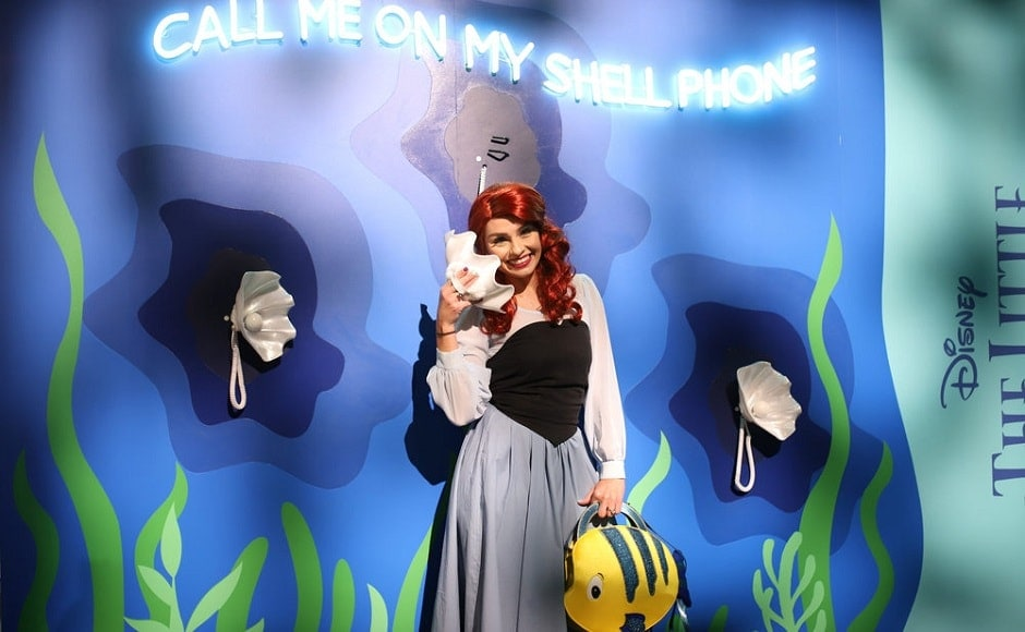 A fan dressed as Ariel from The Little Mermaid at the D23 Expo 2019 | The Walt Disney Company