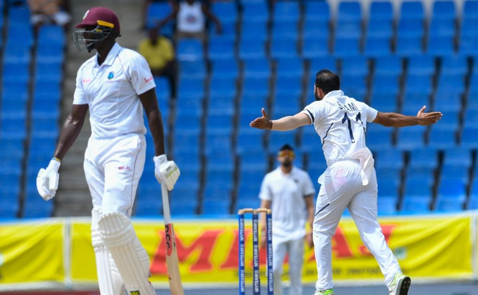 Windies' skipper Jason Holder is dismissed for 39 by Mohammed Shami as the hosts lost their ninth wicket. AFP