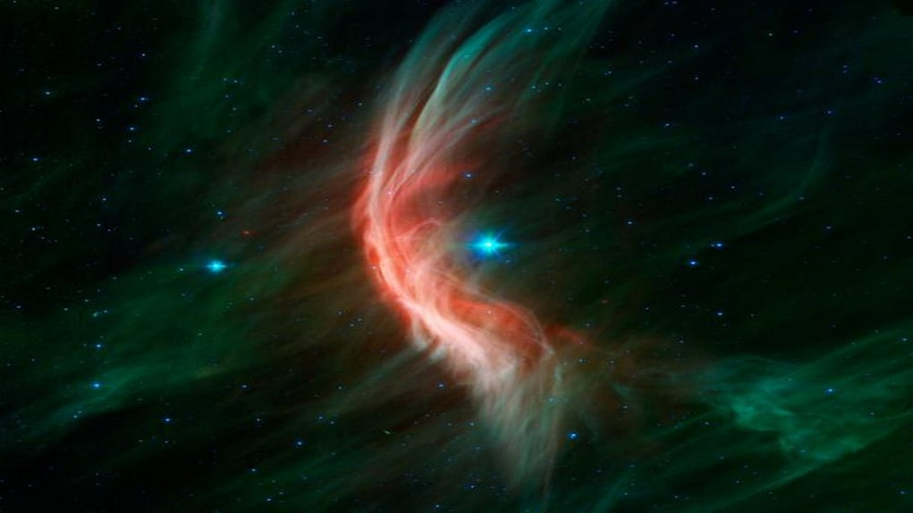 The Spitzer space telescope shows the giant star Zeta Ophiuchi and the bow shock or shock wave in front of it. The bow is only visible in infrared light and is created by winds that flow from the star making ripples in the surrounding dust. Image credit: NASA/JPL
