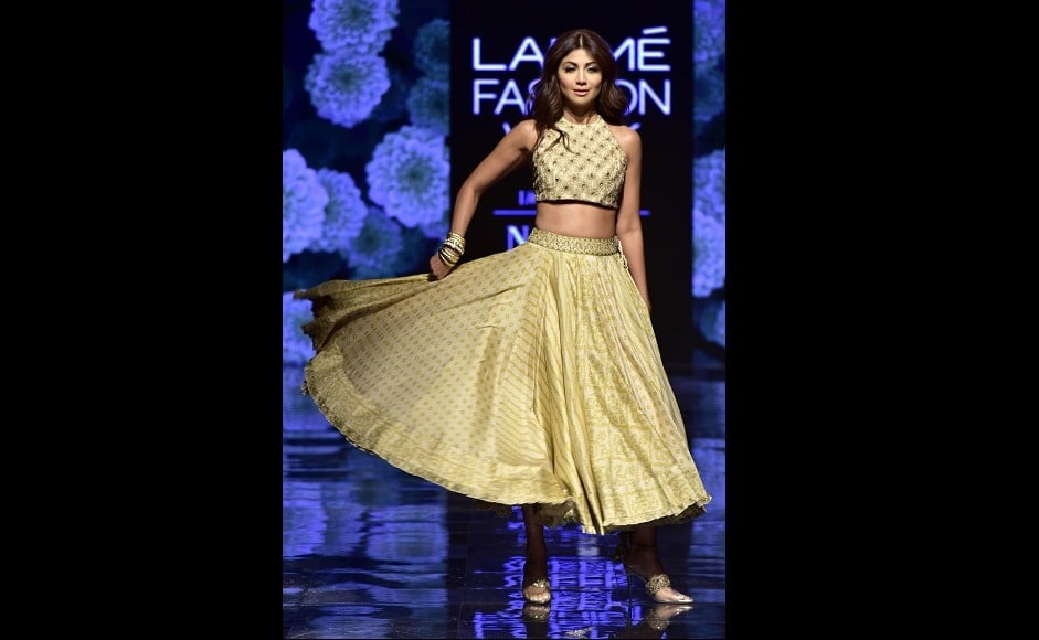 Shilpa Shetty wore a golden lehenga and a matching blouse as she walked down the ramp | Sachin Gokhale