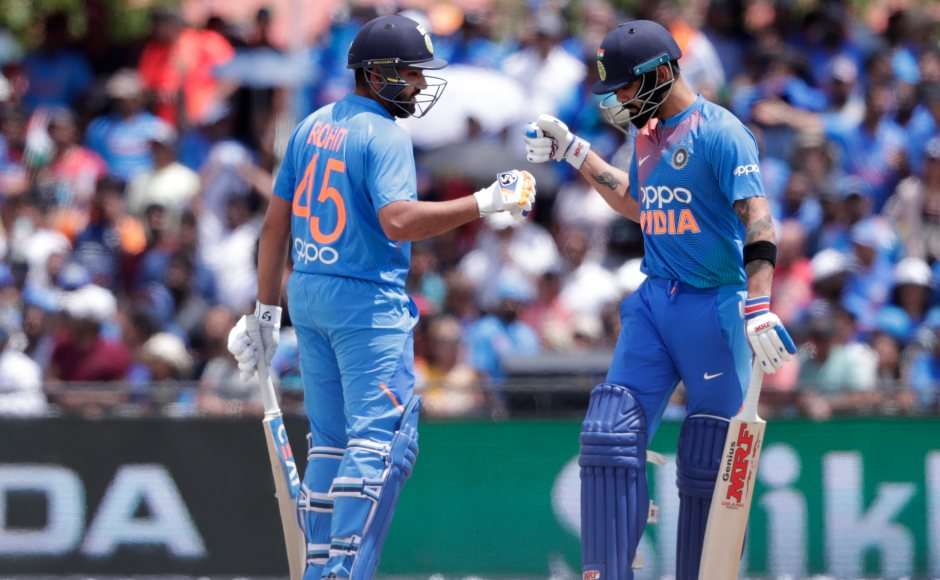 Star batsmen Rohit Sharma (L) and Virat Kohli looked to solidify after Dhawan's departure, but just when they were bringing the Indian innings back on track,Rohit was out caughtoff Sunil Narine's bowling for 24. AP