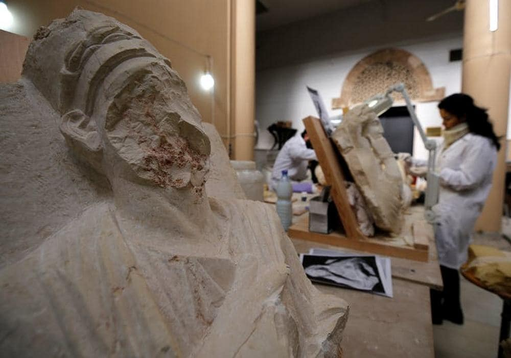 Specialists work on damaged statues from Palmyra at Syria's National Museum of Damascus in January 2019. Image credit: Reuters/Omar Sanadiki