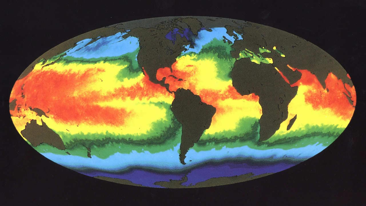 This illustration of Earth's sea surface temperature was obtained from two weeks of infrared observations by the Advanced Very High Resolution Radiometer (AVHRR), an instrument on board NOAA-7 during July 1984. Temperatures are color coded with red being warmest and decreasing through oranges, yellows, greens, and blues. Temperature patterns seen in this image are the result of many influences, including the circulation of the ocean, surface winds, and solar heating. The image indicates a large pool of warm water in the Western Pacific and a tongue of relatively cold water extending along the Equator westward from South America. Every few years, there occurs an interrelated set of changes in the global atmospheric and oceanic circulation known as an El Ni±o in which the region of warm equatorial water in the West extends eastward across the Pacific and blankets the cool, productive regions along the coast of South America. Fish, birds, and marine mammals that depend upon the normally phytoplankton-rich waters often die in large numbers during El Ni±o. Images of sea surface temperature such as this help scientists to better monitor and ultimately understand the changes to Earth caused by events such as El Ni±o. Image credit: NASA