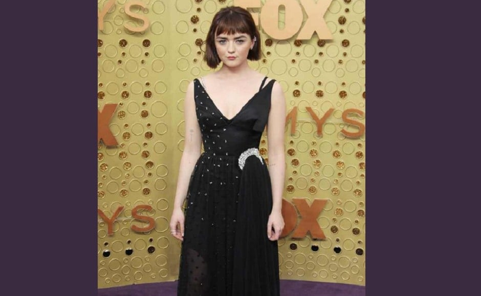 Maisie Williams in a black lace dress that threads down to a asymmetrical piece | Twitter