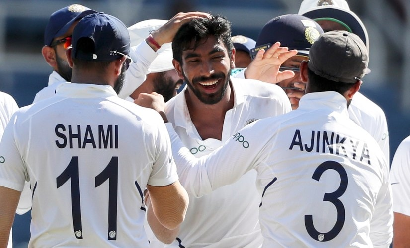 Jasprit Bumrah is congratulated by his teammates after getting his hat-trick. AP